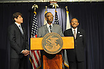 Illinois Congressman Bobby Rush (center) speaks after Illinois Governor Rod Blagojevich (left) announced Roland Burris (right) as Barack Obama's replacement to the U.S. Senate in the Thompson Center in Chicago, Illinois on December 30, 2008.