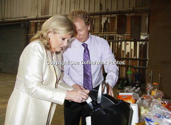 Tina Sloan and Chris J. Handley check out the coffee maker in Empire The Series as it films on set June 3, 2012  in Brooklyn, New York. (Photo by Sue Coflin/Max Photos)