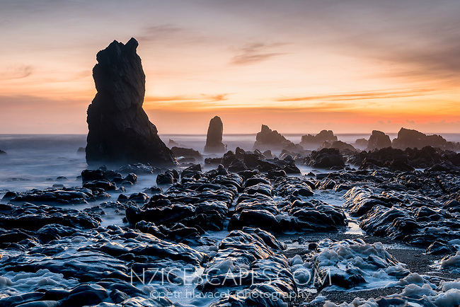 Rocky formations on wild coast near Rapahoe near Greymouth, West Coast, New Zealand, NZ