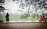 VIETNAM, Hanoi, a woman is taking picture of Hoan Kiem Lake