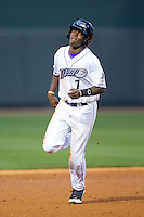 Tim Anderson (7) of the Winston-Salem Dash runs the bases during the game against the Wilmington Blue Rocks at BB&T Ballpark on April 5, 2014 in Winston-Salem, North Carolina.  The Dash defeated the Blue Rocks 3-2.  (Brian Westerholt/Four Seam Images)