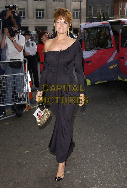 PATSY PALMER.Attends the Glamour Women of the Year Awards 2005,.Berkeley Square, London, .June 7th 2005..full length black dress earrings gold bag .Ref: FIN.www.capitalpictures.com.sales@capitalpictures.com.©Steve Finn/Capital Pictures.