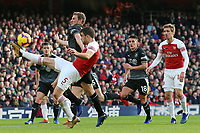 Arsenal's Sokratis Papastathopoulos clears the danger away from Burnley's Chris Wood<br /> <br /> Photographer David Shipman/CameraSport<br /> <br /> The Premier League - Arsenal v Burnley - Saturday 22nd December 2018 - The Emirates - London<br /> <br /> World Copyright © 2018 CameraSport. All rights reserved. 43 Linden Ave. Countesthorpe. Leicester. England. LE8 5PG - Tel: +44 (0) 116 277 4147 - admin@camerasport.com - www.camerasport.com