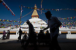 People make their prayer rounds around Boudhanath Stupa (or Bodnath Stupa), the largest stupa in Kathmandu, Nepal. The Stupa is the center of Tibetan culture in Kathmandu and rich in Buddhist symbolism and of sacred importance.