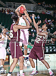 North Texas Mean Green forward Ash'Lynne Evans (1) grabs a rebound from University of Louisiana at Monroe Warhawks forward Sannisha Williams (32) and University of Louisiana at Monroe Warhawks center Larrie Williams (35) during the NCAA Women's basketball game between the University of Louisiana at Monroe Warhawks and the University of North Texas Mean Green at the North Texas Coliseum,the Super Pit, in Denton, Texas. ULM defeated UNT 50 to 47.