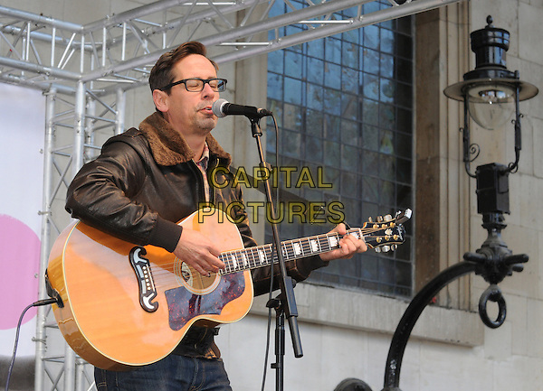 Nick Heyward of The View.BBC Children In Need's Pudsey Street -photocall, New Piazza, Covent Garden, London, England..3rd November 2012.on stage in concert live gig performance performing music half length black leather jacket glasses singing guitar .CAP/PP/BK.©Bob Kent/PP/Capital Pictures