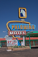 Sign for the Palomino Motel in Tucumcari, New Mexico on Route 66. the Motel is still open for business.
