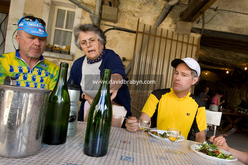 Winemaker Claudette Jarry (C) talks about her wines to writer David Darlington (L) and Larry Athan, participants in a Backroads cycle tour of the Loire Valley, at her cellars in Vouvray, France, 26 June 2008.