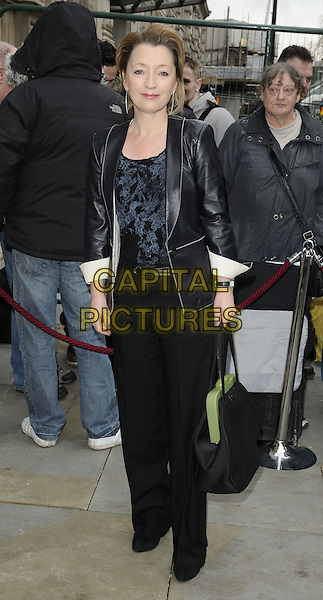 LESLEY MANVILLE .Attending the British Academy Film Awards (BAFTA) nominees brunch, Corinthia London Hotel, London, England, UK, February 12th 2011..full length black leather jacket trousers bag blue print top .CAP/CAN.©Can Nguyen/Capital Pictures.