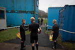 The match officials waiting for the teams to emerge from the changing rooms before Cambrian and Clydach Vale take on Cwmbran Celtic at King George's New Field in a Welsh League Division One match, the top division of the Welsh Football League and the second level of the Welsh football league system. The club, formed in 1965 reached the final of the 2018-19 League Cup final and can count on ex-England manager Terry Venables as a former club chairman. Cambrian and Clydach Vale won this match 2-0, watch by a crowd of around 100 spectators.