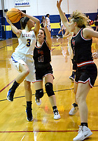 Westside Eagle Observer/MIKE ECKELS<br /> <br /> Finding he path to the basket blocked by a pair of Lady Highlander defenders, Destiny Mejia (3) passes the ball to a team mate standing near the left wing during the Decatur-Eureka Springs girls conference contest in Decatur Jan. 7.