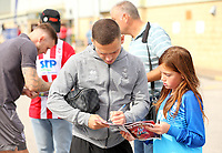 Lincoln City's Jack Payne signs autographs for waiting fans as he arrives ahead of kick-off at SIncil Bank<br /> <br /> Photographer Rich Linley/CameraSport<br /> <br /> The EFL Sky Bet League One - Lincoln City v Bristol Rovers - Saturday September 14th 2019 - Sincil Bank - Lincoln<br /> <br /> World Copyright © 2019 CameraSport. All rights reserved. 43 Linden Ave. Countesthorpe. Leicester. England. LE8 5PG - Tel: +44 (0) 116 277 4147 - admin@camerasport.com - www.camerasport.com