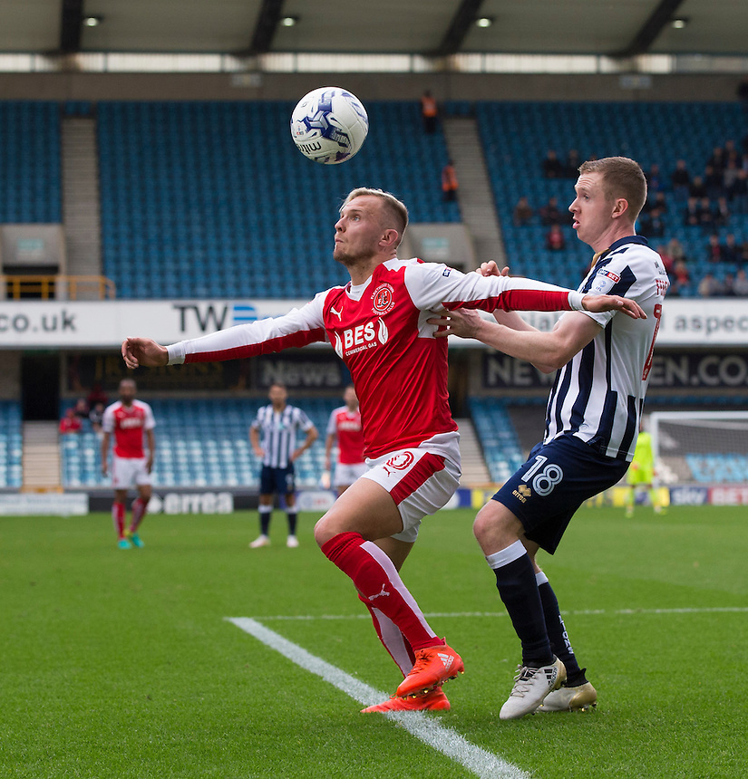 Fleetwood Town's David Ball holds off the challenge from Millwall's Shane Ferguson<br /> <br /> Photographer Craig Mercer/CameraSport<br /> <br /> The EFL Sky Bet League One - Millwall v Fleetwood Town - Saturday 22nd October 2016 - The Den - London<br /> <br /> World Copyright &copy; 2016 CameraSport. All rights reserved. 43 Linden Ave. Countesthorpe. Leicester. England. LE8 5PG - Tel: +44 (0) 116 277 4147 - admin@camerasport.com - www.camerasport.com