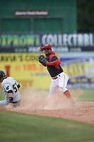 Batavia Muckdogs shortstop Marcos Rivera (8) turns a double play as Deon Stafford (57) slides into second base during a game against the West Virginia Black Bears on June 25, 2017 at Dwyer Stadium in Batavia, New York.  West Virginia defeated Batavia 6-4 in the completion of the game started on June 24th and suspended in the bottom of the third inning due to a heavy downpour.  (Mike Janes/Four Seam Images)