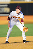 Third baseman Kyle Geason #4 of the Minnesota Golden Gophers on defense against the Towson Tigers at Gene Hooks Field on February 26, 2011 in Winston-Salem, North Carolina.  The Gophers defeated the Tigers 6-4.  Photo by Brian Westerholt / Sports On Film