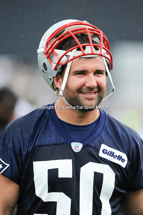 July 24, 2014 - Foxborough, Massachusetts, U.S.- New England Patriots defensive end Rob Ninkovich (50) leaves the practice field under a light rain during the New England Patriots training camp held at Gillette Stadium in Foxborough Mass.Eric Canha/CSM
