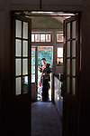 A lady who works at the Tripura castle feeds her baby  in the verandah by the kitchen.