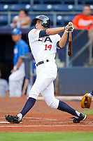 George Springer #14 of Team USA follows through on his swing against Team Korea at Durham Bulls Athletic Park July 18, 2010, in Durham, North Carolina.  Photo by Brian Westerholt / Four Seam Images