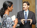 Newsday reporter Sumathi Reddy interviewing Suffolk executive, Steve Levy, after a press conference to announce the appointment of Rev. Dr. Beresford Adams to the post of Assistant to Suffolk Police Commissioner for Minority Affairs at County Executives suite in Dennison Building in Hauppauge on Tuesday September 7, 2004.(Newsday Photo / Jim Peppler).