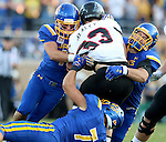 BROOKINGS, SD - SEPTEMBER 12:  Nick Mears #42, Shayne Gottlob #98 and Jesse Bobbit #7 from South Dakota State brings down Jarom Healey #33 from Southern Utah in the first half of their game Saturday night in Brookings. (Photo by Dave Eggen/Inertia)
