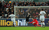 Jamie Vardy of Leicester City (9) fails to score, Lukasz Fabianski of Swansea deflects the ball, during the Barclays Premier League match between Swansea City and Leicester City at the Liberty Stadium, Swansea on December 05 2015