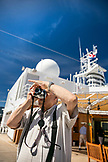 CANADA, Vancouver BC, a man snaps photos while onboard the the Holland America cruise ship, the Oosterdam, while it's at port by the Canada Place, British Columbia