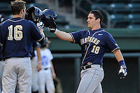 First baseman Steven Shelinsky Jr. (18) of the University of Pittsburgh Panthers is congratulated by Jordan Frabasilio (16) after hitting a home run in a game against the Presbyterian Blue Hose on Tuesday, March 11, 2014, at Fluor Field at the West End in Greenville, South Carolina. Pitt won, 12-3. (Tom Priddy/Four Seam Images)