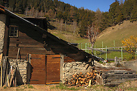 Typical Swiss chalet in spring. Rural countryside of Switzerland.