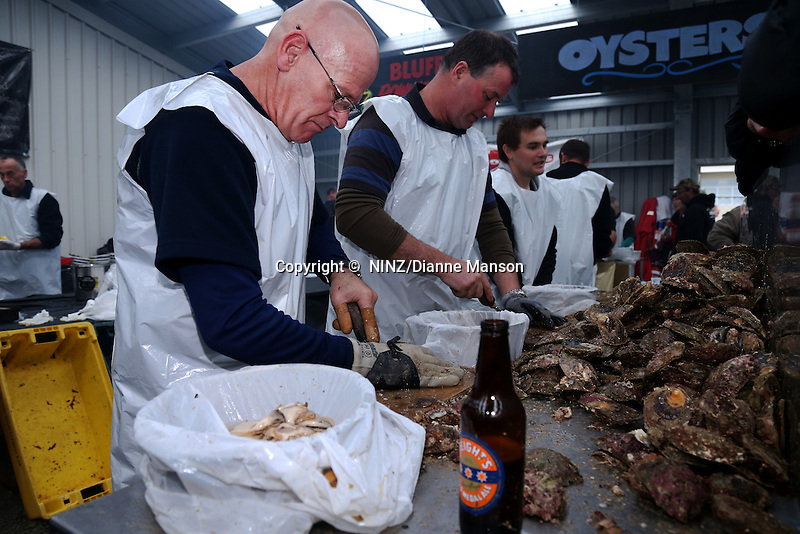Steve Geary, of Barnes Oysters, shucks oysters for the public to eat during the Bluff Oyster and Food Festival, Bluff, New Zealand, Saturday, May 21, 2016. Credit:  Dianne Manson