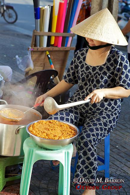 Woman Cooking On Sidewalk