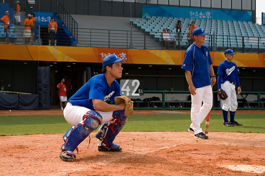 17 August 2007: Catcher Boris Marche practices, next to Jeff Zeilstra and Patrick Carlson during the Good Luck Beijing International baseball tournament (olympic test event) at the Wukesong Baseball Field in Beijing, China.