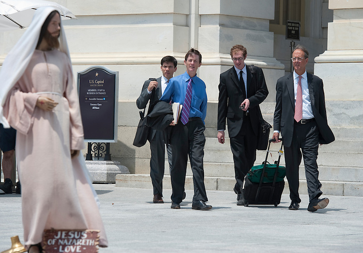 UNITED STATES - JULY 22:  Businessman and political figure from North Carolina Erskine Bowles gives a double take to Jesus on the East Front of the U.S. Capitol as he leaves the building on July 22, 2010..(Photo By Douglas Graham/Roll Call via Getty Images)