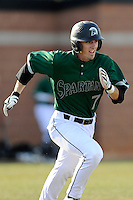 Left fielder Stephen Dowling (7) of the University of South Carolina Upstate Spartans runs out a grounder in a game against the Citadel Bulldogs on Tuesday, February, 18, 2014, at Cleveland S. Harley Park in Spartanburg, South Carolina. Upstate won, 6-2. (Tom Priddy/Four Seam Images)