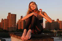 Gregory Holmgren Photographer, NYC dance, movement project with model, dancer Julie Justine at The ClockTower Rooftop, Bronx, New York, New York, September 12, 2012.