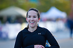This photograph is of a woman with a broad smile as she crosses the finish line at the Quad Cities Marathon 2010