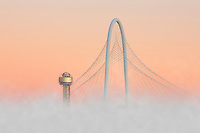 With fog rising from the Trinity River Basin, this image of the Margaret Hunt Hill Bridge and Reunion Tower was shows low moving mist enveloping the Dallas icons on a cold, December morning.