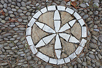 Exterior image of a geometric pattern on the stones, made from larger white stones.