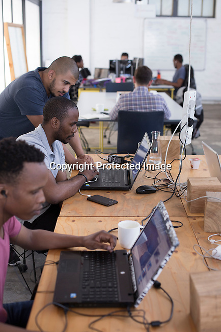 """CAPE TOWN, SOUTH AFRICA NOVEMBER 22: Techies work in a shared office space called """"Woodstock Exchange"""", where entrepreneurs and small businesses rent office space on November 22, 2016 in Woodstock outside central Cape Town, South Africa. (Photo by: Per-Anders Pettersson)"""
