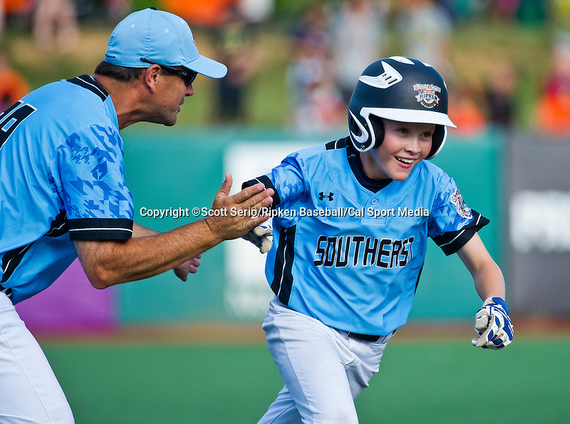 August 15, 2014: Scenes from West Raleigh's 7-5 victory against Harford County for the United States Championship during the Cal Ripken 12u 70-foot World Series United States Championship at the Ripken Experience powered by Under Armour in Aberdeen, Maryland on August 15, 2014. Scott Serio/Ripken Baseball/CSM