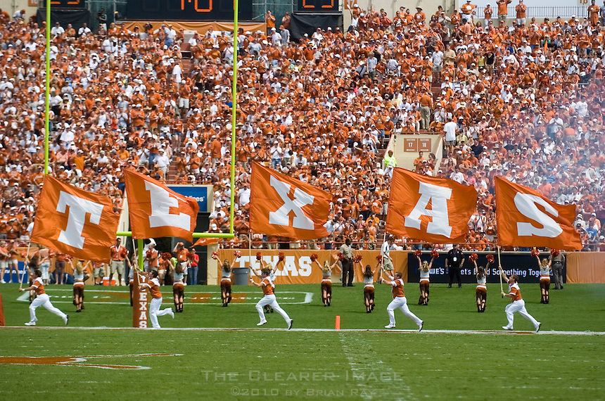 02 September 2006: University of Texas cheerleaders celebrate by running flags through the endzone after a touchdown during the Longhorns 56-7 victory over the University of North Texas at Darrell K Royal Stadium in Austin, TX.