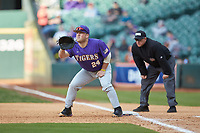 LSU Tigers first baseman Cade Beloso (24) holds a runner on first as umpire Ken Langford looks on during the game against the Baylor Bears in game five of the 2020 Shriners Hospitals for Children College Classic at Minute Maid Park on February 28, 2020 in Houston, Texas. The Bears defeated the Tigers 6-4. (Brian Westerholt/Four Seam Images)