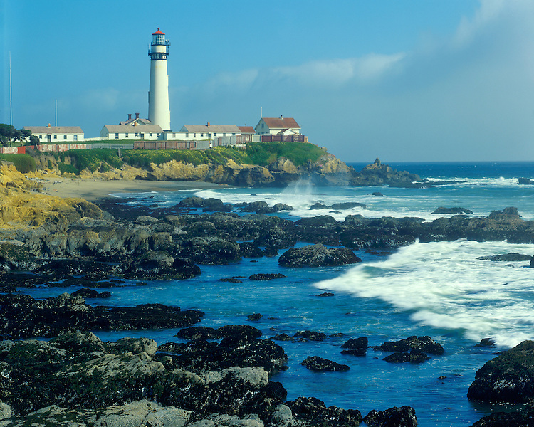 Foggy evening light on surf and Pigeon Point Lighthouse at low tide; Highway 1, CA