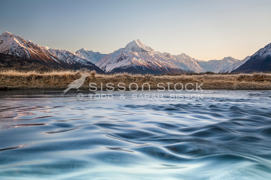 Winter sunrise looking across the Tasman River towards Aoraki / Mt Cook covered in snow, Mackenzie Country, Canterbury, New Zealand