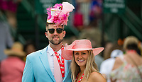 LOUISVILLE, KY - MAY 04: A man and woman pose for a photo, both wearing their fancy pink hats on Kentucky Oaks Day at Churchill Downs on May 4, 2018 in Louisville, Kentucky. (Photo by Eric Patterson/Eclipse Sportswire/Getty Images)