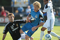 San Jose Earthquakes forward Steven Lenhart (24) battles against Los Angeles Galaxy goalkeeper Josh Saunders (12). The San Jose Earthquakes tied the Los Angeles Galaxy 0-0 at Buck Shaw Stadium in Santa Clara, California on June 25th, 2011.