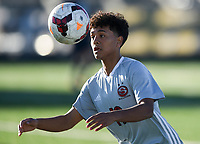 NWA Democrat-Gazette/CHARLIE KAIJO Springdale High School Irvin Sotero (19) heads the ball during a soccer game, Friday, March 15, 2019 at Bentonville West in Centerton.
