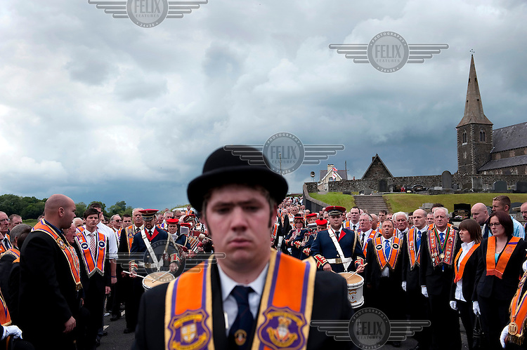 Orangemen walk towards Drumcree church during their annual parade, in Belfast. Since 1998 the marchers have been stopped from marching through a catholic part of the town, they now walk to the police lines, register their protest and disperse...