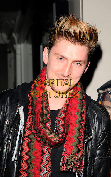 HENRY HOLLAND.Nokia & PPQ Launch Party at PPQ Boutique, Conduit Street, London, England, January 29th 2008..portrait headshot red green scarf patterned knitted.CAP/CAN.©Can Nguyen/Capital Pictures
