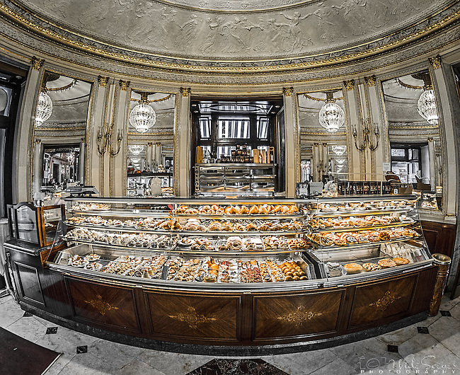 A fisheye shot of the pastry counter at the Gambrinus Cafe in Naples, Italy. This famous cafe has been operating since 1860 and is conveniently located in the Centro Storico (Historical Centre) adjacent to Piazza Plebiscito and the Royal Palace.