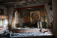 Kharsavey,Yamal Peninsula, Russia, 10/07/2010..Lenin backdrop onstage inside the dilapidated House of Culture of the Karsk Expedition, abandoned during the 1997 Russian financial crisis.